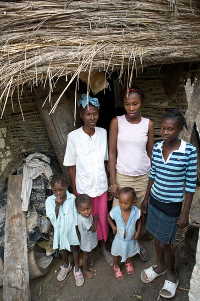 Haitian family in front of their home. (Photo courtesy of Mission to Haiti)